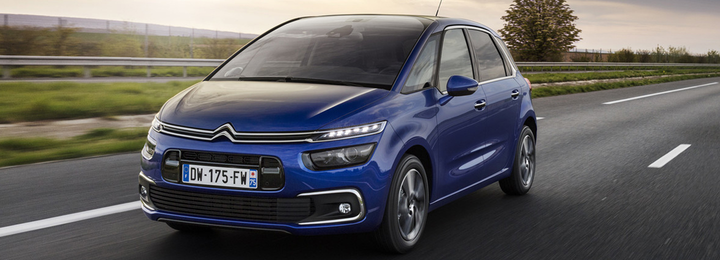 Fotografía exterior de un citroen c4 de color azul